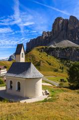 Church on Passo Gardena in Dolomites Mountains in autumn, Italy