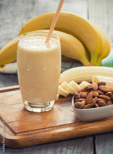 Fresh made Banana smoothie on wooden background - 81463325