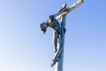 the crucifixion of Jesus Christ on top of the dolomites alps