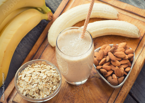 Fresh made Banana smoothie on wooden background - 81464197