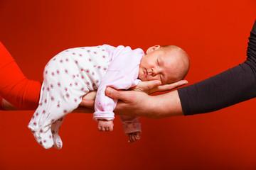 newborn baby girl in the comfort of moms arms