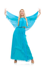 Woman dances in gentle blue dress isolated on white