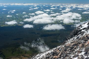 cumulus clouds gathering around Mount Taranaki in New Zealand