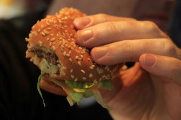 Man holding a hamburger