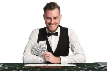 Smiling black jack dealer