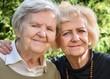 Senior and mature women in garden.