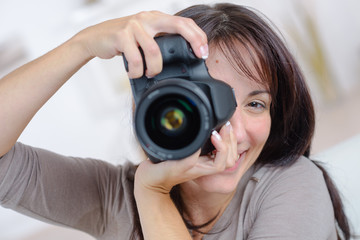 Woman taking a photograph