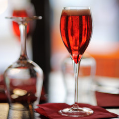 Glass with French alcohol drink Kir Royal