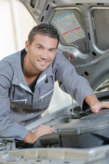 Mechanic stood by a car