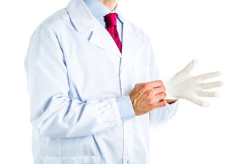 Doctor in white coat wearing disposable latex gloves