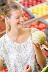 Woman picking a melon