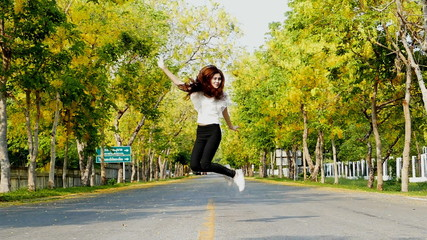 Young woman jump in summer on street, slow motion Concept.