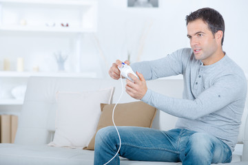 Guy playing a video game
