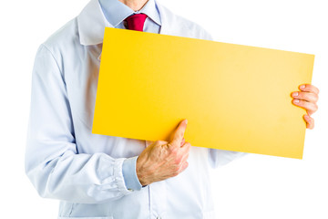 Doctor in white coat showing a yellow signboard