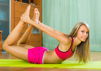 Young woman having pilates indoor