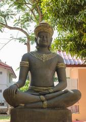 statue for Khmer deva sitting under sunlight