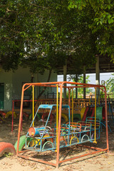 the old equipment under sunlight at playground