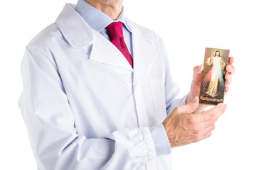 Doctor in white coat holding Merciful Jesus icon
