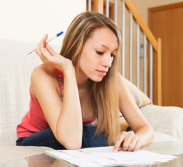 student girl carefully studying the notes