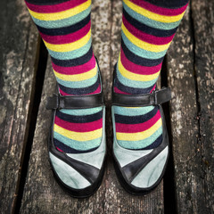 Female legs in striped socks in vintage style
