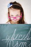 Miserable girl standing behind the blackboard poster