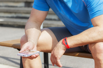 athlete checking fitness data wearable