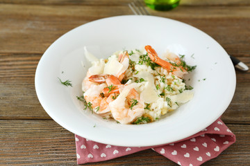 Rice with shrimp and dill on a plate
