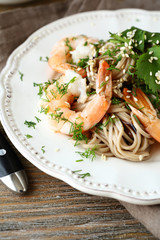 Buckwheat noodles with shrimp on a plate