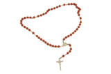 Wood rosary and metal cross with slightly unfocused beads