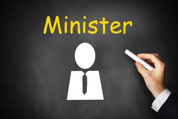 hand writing minister on black chalkboard