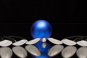 Blue Christmas decoration and six spoons