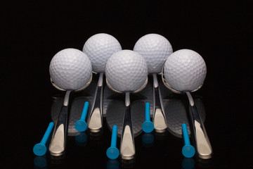 Five spoons and golf balls