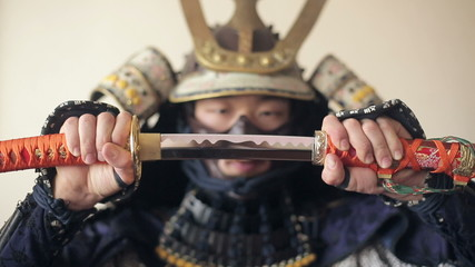 ancient Japanese samurai opens up his sword, close-up