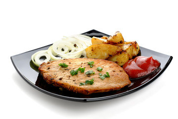 Roasted steak with baked potatoes, onion and ketchup