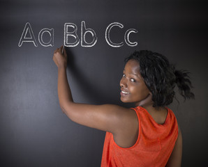 African American woman teacher learn alphabet write writing