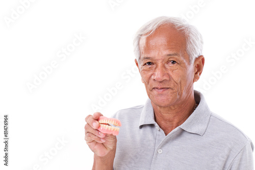 Poster old senior man with hand holding denture