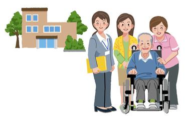車いす シニア Smiling senior man in wheelchair with caregivers