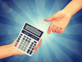 Hand passing a calculator