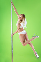 Girl in angelic wings makes element at pole dance