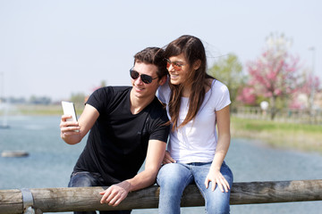 Couple Having Fun with Smartphone Photography