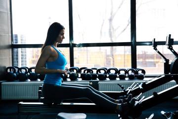 Beautiful woman working out on simulator