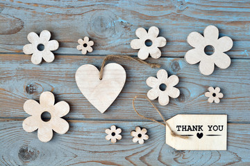 Wooden background with flowers and thank you label
