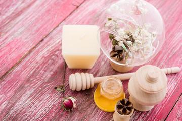 spa treatment -  star anise, honey, salt, arranged with soap bar