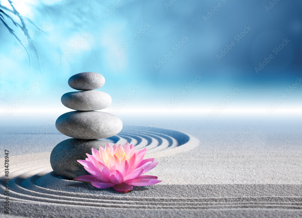 sand, lily and spa stones in zen garden