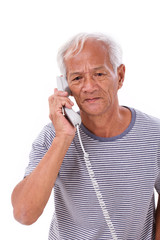 sad, frustrated, negative senior old man talking via home teleph