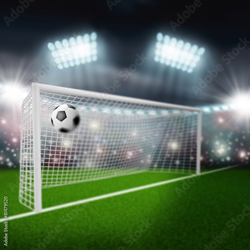 soccer ball flies into the goal - 81479520