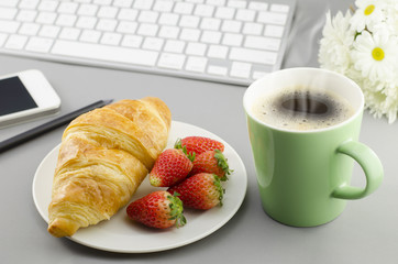 Breakfast with croissant,coffee and strawberry