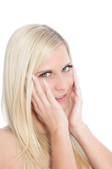 Close Up of Blond Woman Touching Face in Hands