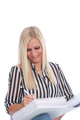 Blond Woman in Striped Shirt Writing in Binder