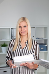 Blond Businesswoman Casually Dressed in Office